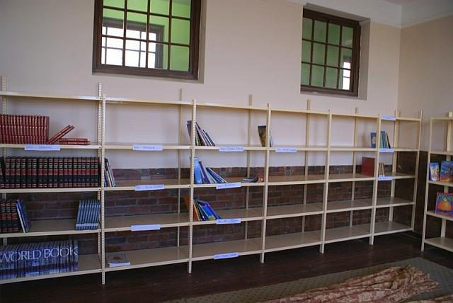 Waterfront Rotary Club: Almost bare library shelves